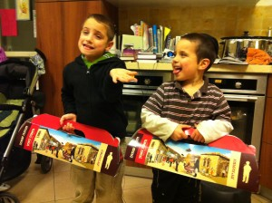 Yitzi & Shalom display the festive sufganiyot boxes from the bakery.