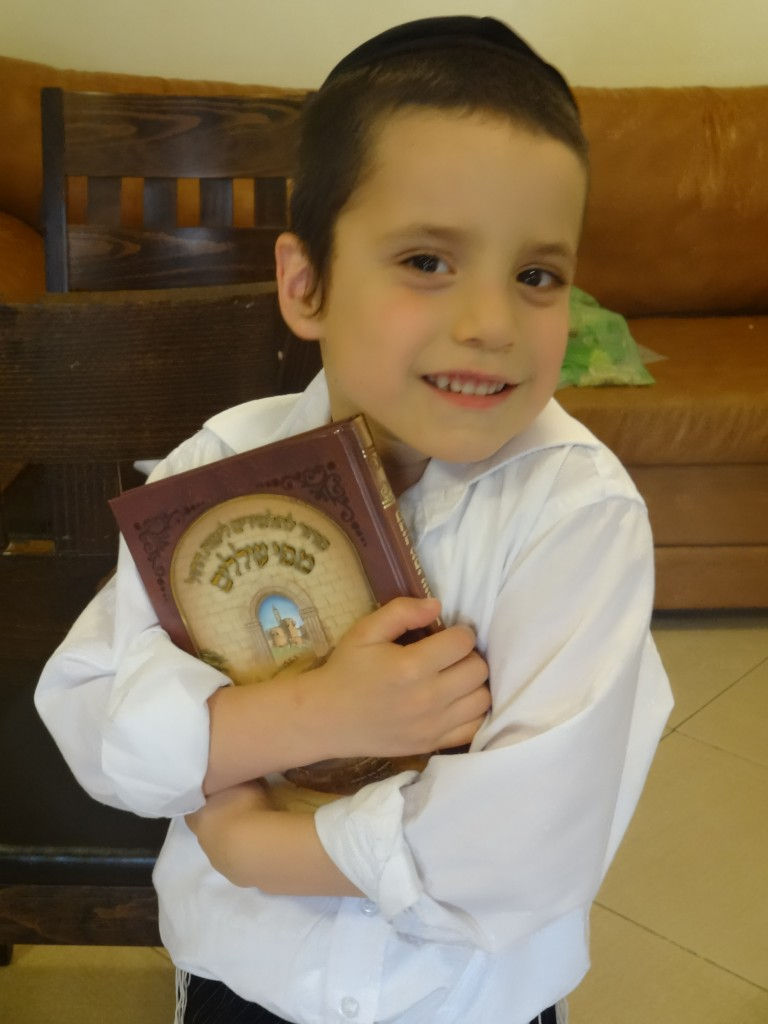Shalom Gershon with the siddur he got from mechina at the end of the school year.